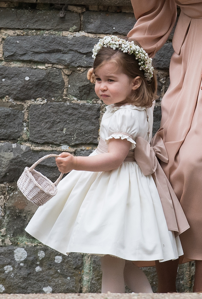 princess charlotte carrying a basket, dressed in a white dress, with ivory bow, flower girl dresses