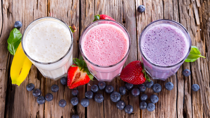 tall glasses, on wooden table, healthy smoothie recipes, berries and bananas