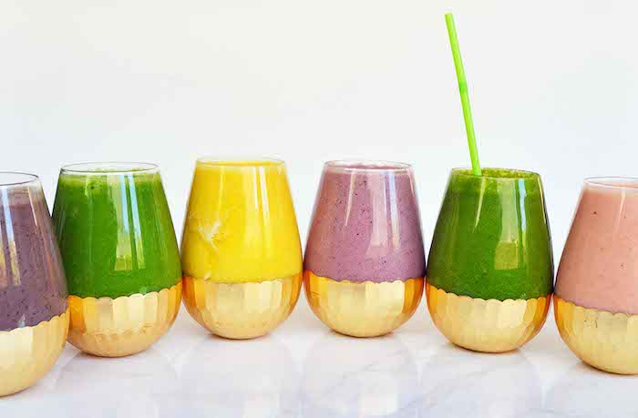fruit smoothie recipes, different ingredients, colourful smoothies, in glasses with gold bottom