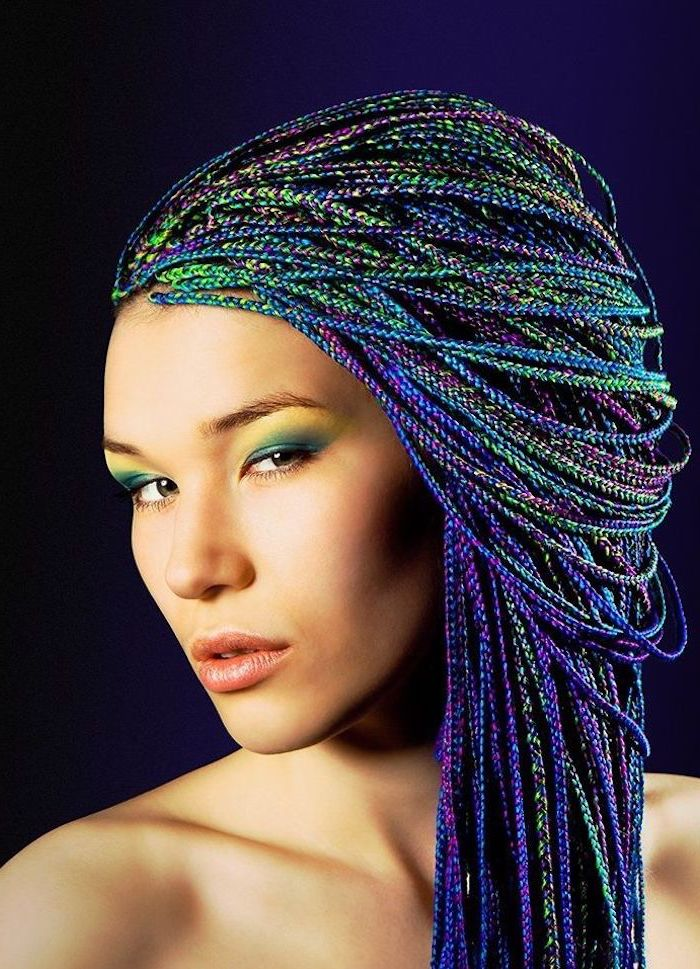 cute braid styles, rainbow coloured hair, woman standing in front of a blue background
