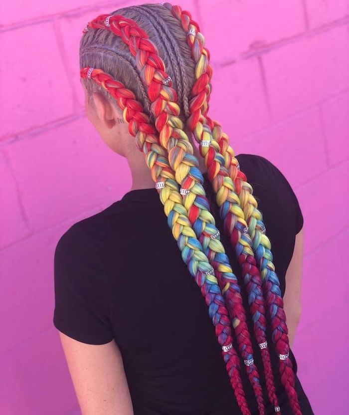 rainbow coloured braids with beads, cute braid styles, pink brick wall, girl wearing a black top