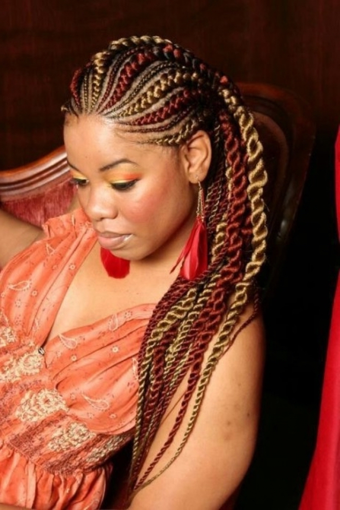 red and blonde hair, orange dress, red feather earrings, braiding styles with weave