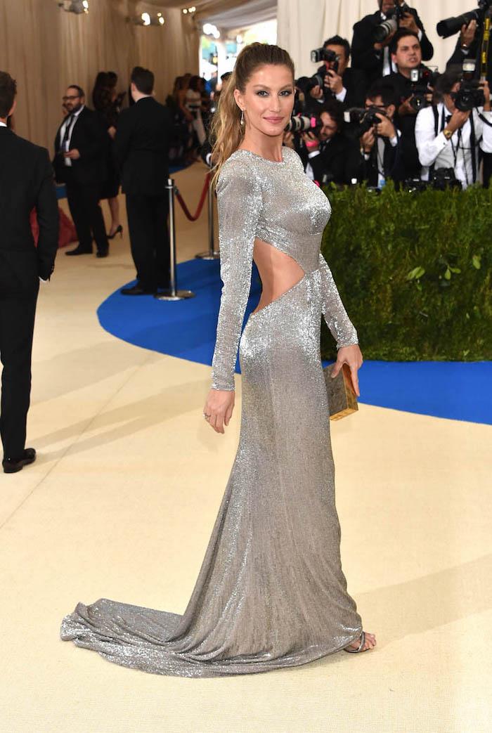 gisele bundchen, long silver metallic dress, silver sandals, met gala fashion, brown hair, in a ponytail