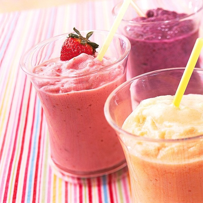 strawberry banana yogurt smoothie, different smoothies, yellow straws, colourful cloth
