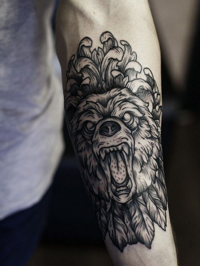 roaring lion head, forearm tattoo, tattoos for men, grey shirt, blurred background