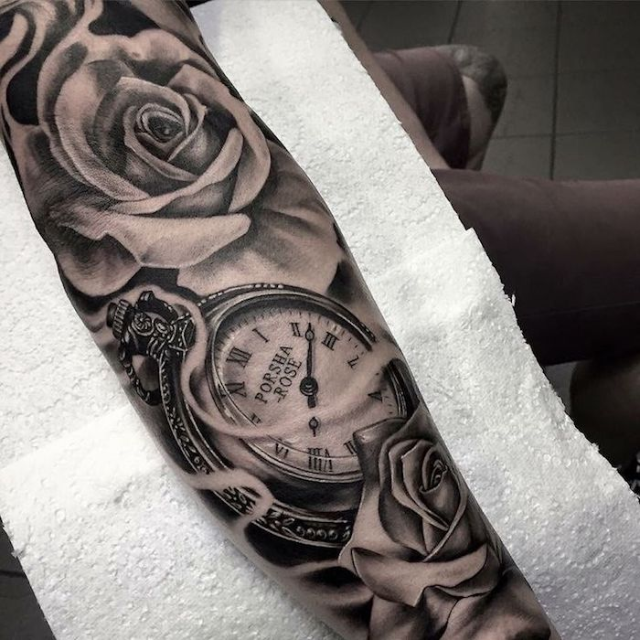 pocket watch with roses, hand on white paper, tattoo ideas for men arm