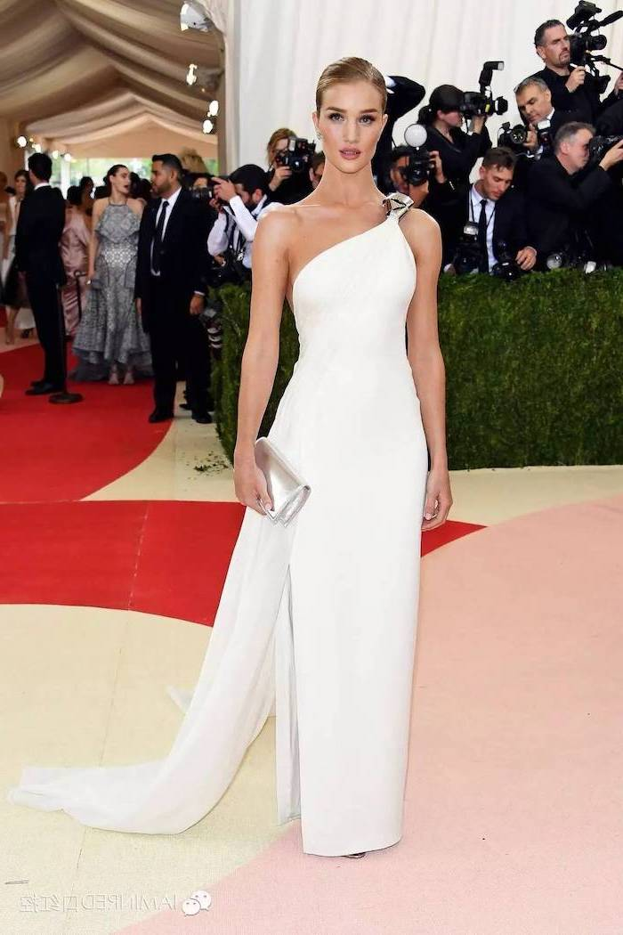 rosie huntington whiteley, in a long white dress, costume institute, blonde hair, in a low updo, silver clutch bag