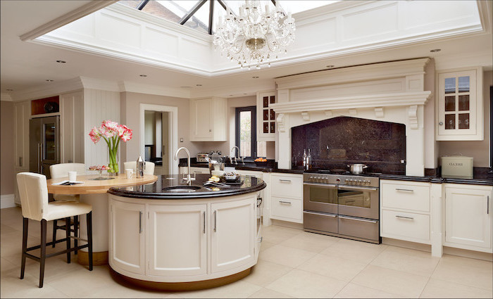 round and curved, kitchen island with bar seating, white leather bar stools, white tiled floor, white cabinets