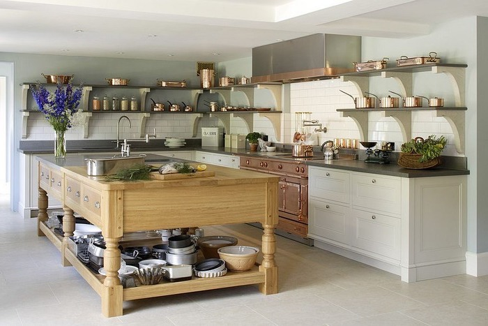 wooden kitchen island, open shelving, kitchen island with bar seating, hanging shelves, brass utensils