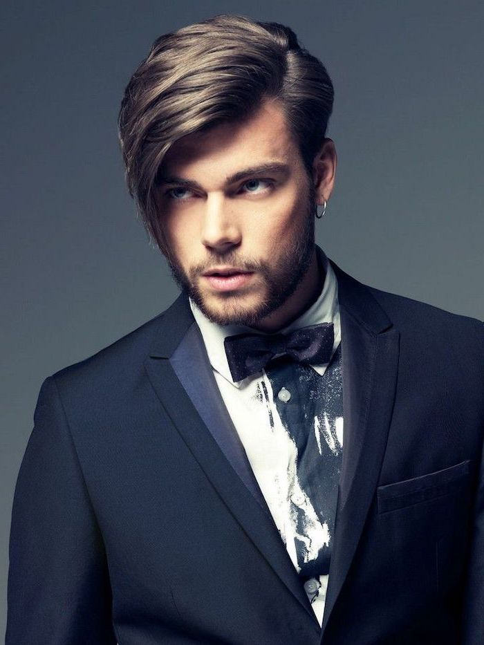 trendy haircuts for men, blonde hair, black suit, black bow tie, white shirt