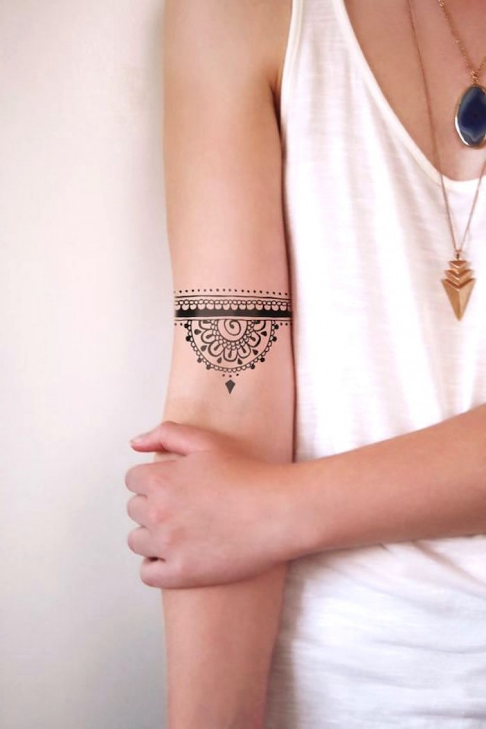 white top, tattoos for girls on hand, gold necklaces, mandala inside arm tattoo