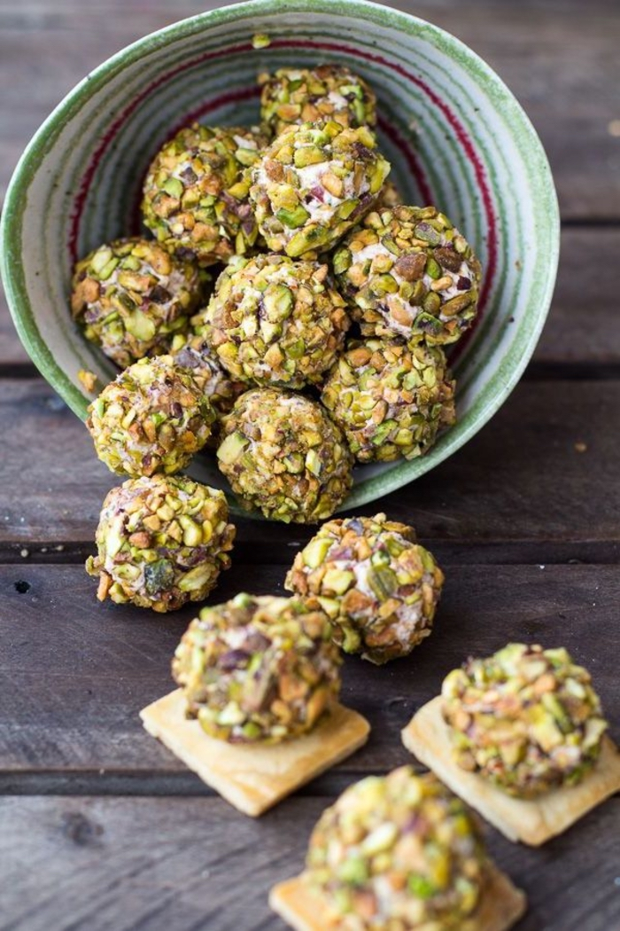 cheese pistachio bites, inside a green and red bowl, vegetarian appetizers, bites on crackers