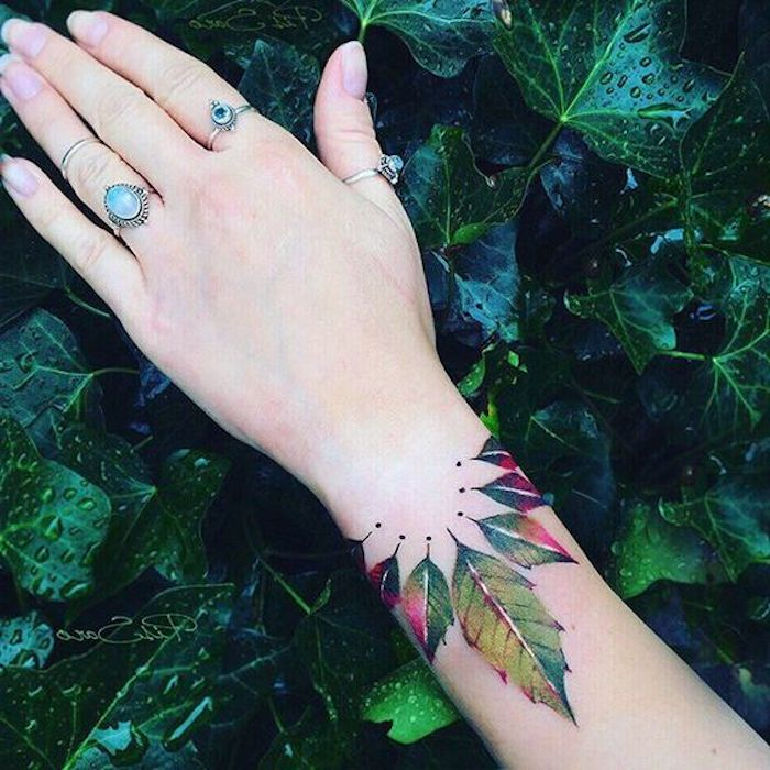 feminist tattoos, green leaves, wrist tattoo, vintage rings