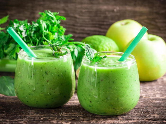 green smoothies, in two glasses, green straws, strawberry banana yogurt smoothie, apples and avocado
