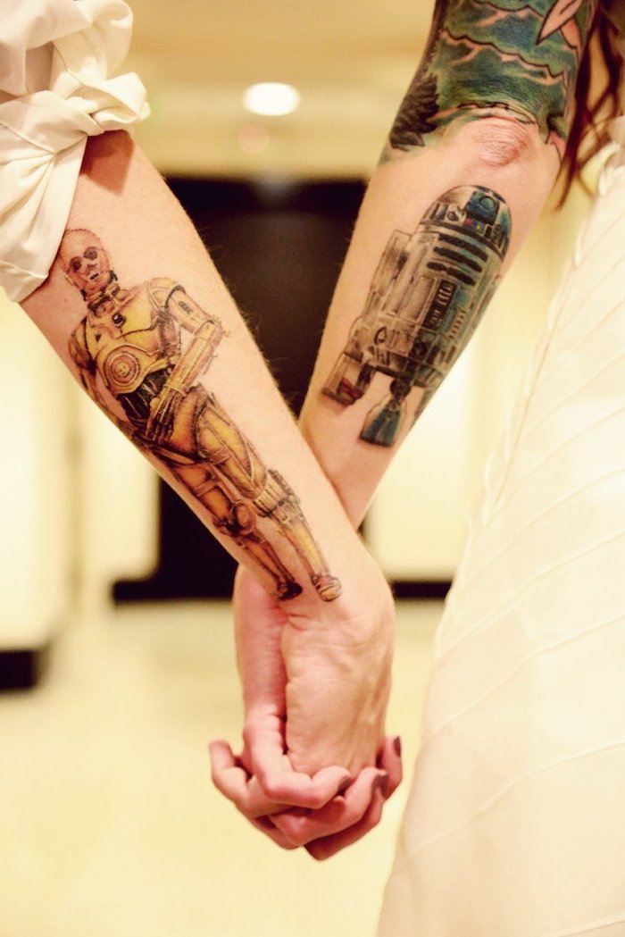 star wars inspired, his and hers matching tattoos, back of arm tattoos, large hallway