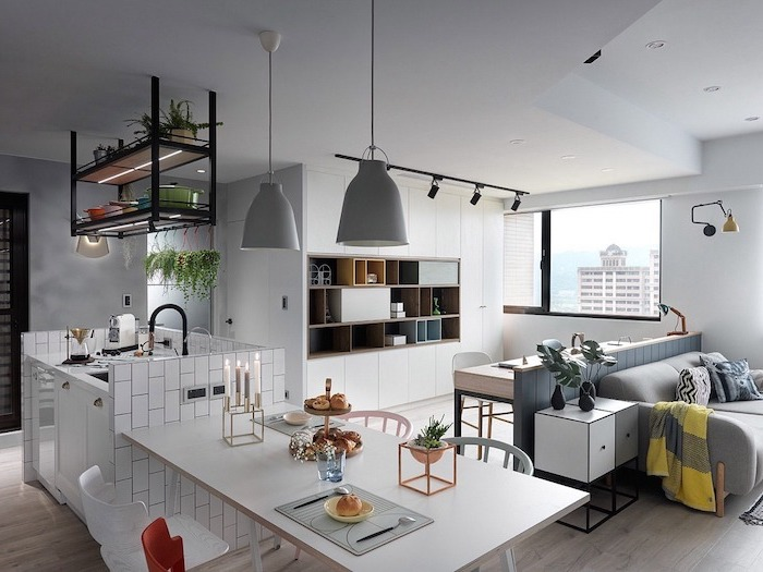 hanging black metal shelves, floating kitchen island, made with white subway tiles, wooden floor