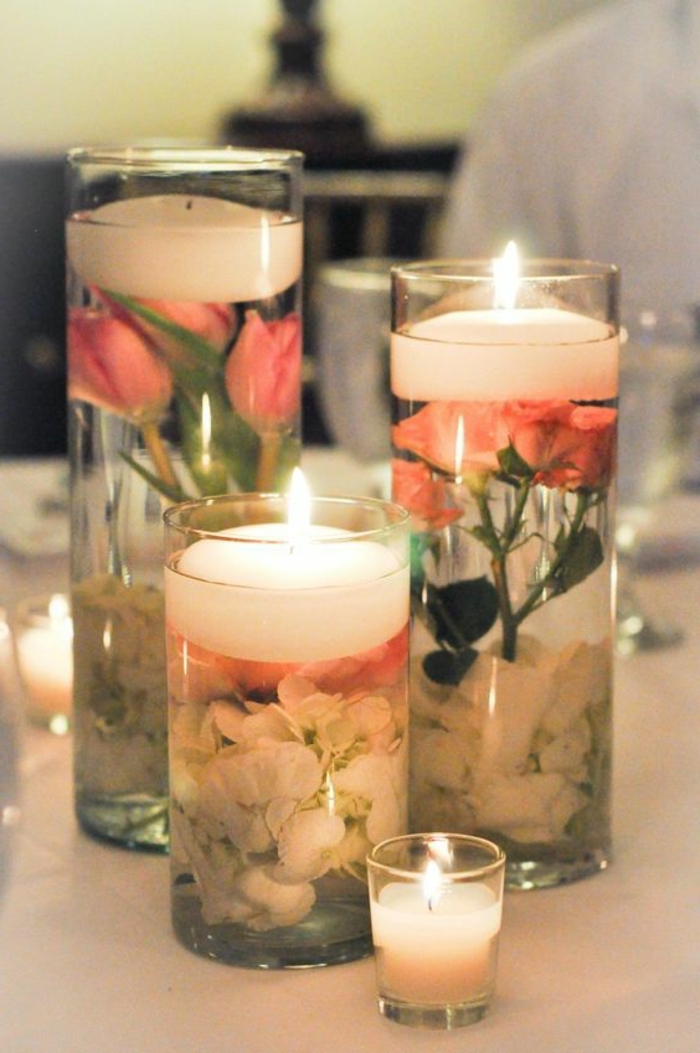tall round vases, filled with water and flowers, candles on top, how to make candles at home