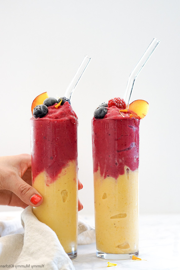 layered smoothie, fruits on top, peanut butter banana smoothie, in tall glasses