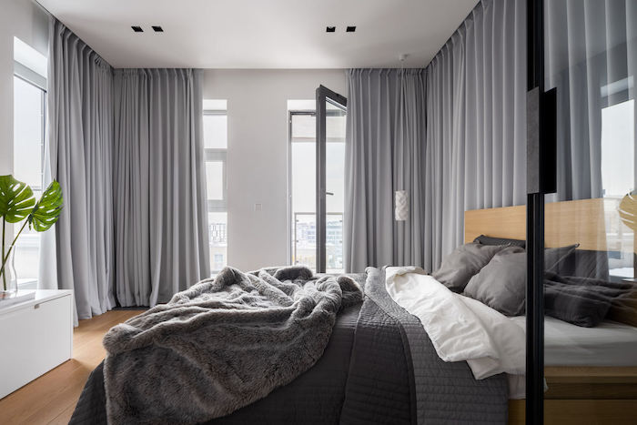 tall windows, grey curtains, over the bed decor, wooden floor, grey bed linen