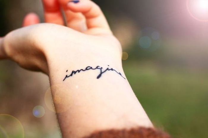 imagine wrist tattoo, meaningful tattoo ideas, blurred background