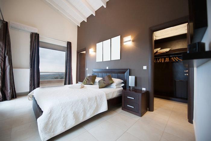 brown accent wall, tiled floor, pinterest bedroom, wooden bed frame, walk in closet