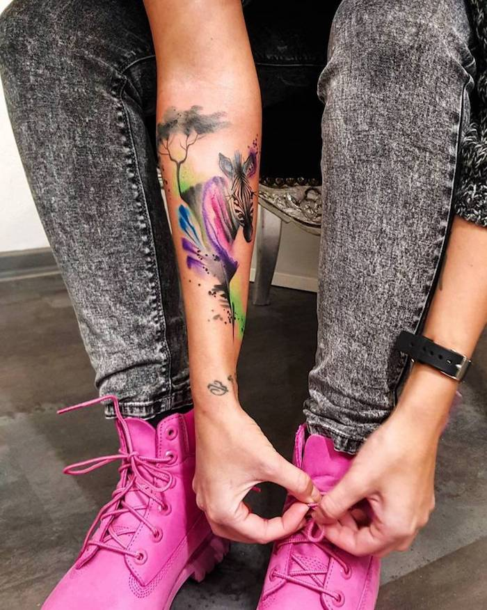 watercolour zebra, forearm tattoo, small tattoo ideas for men, pink boots, washed jeans