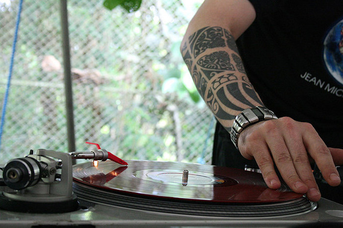 tribal tattoo, small tattoos for guys, dj vinyl, silver watch