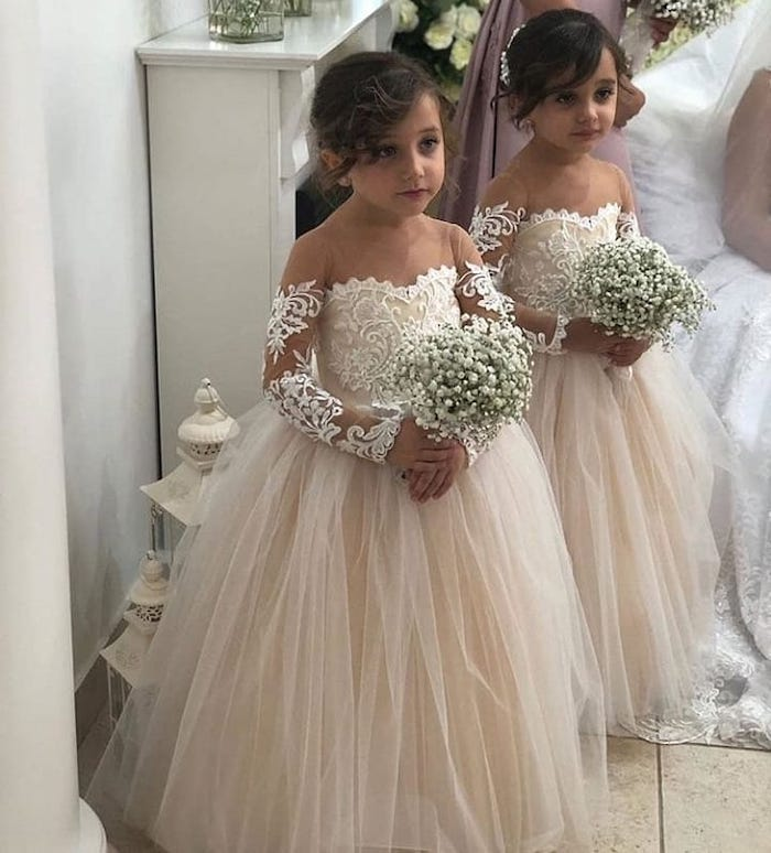 two girls, in ivory lace and tulle dresses, toddler flower girl dresses, baby's breath bouquets