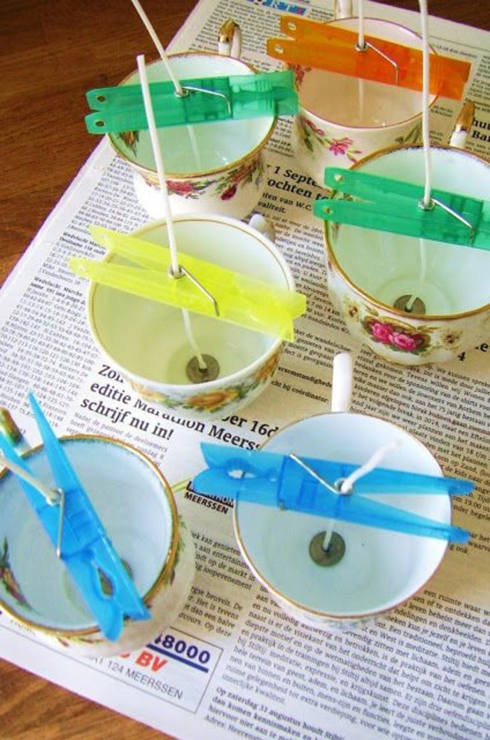 make your own candles, vintage tea cups, candle wicks inside, held with clothespins
