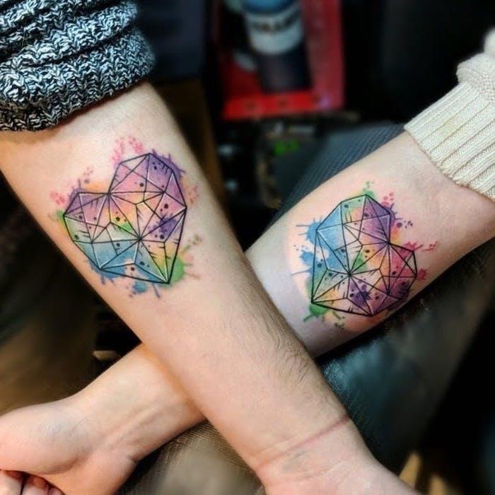 boyfriend and girlfriend matching tattoos, watercolour forearm tattoo, geometric hearts