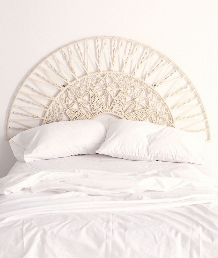 macrame bed frame, white bed linen, macrame tapestry, white wall