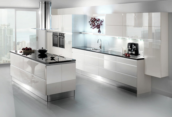 white cabinets and drawers, black countertop, kitchen island with seating for 4, white floor