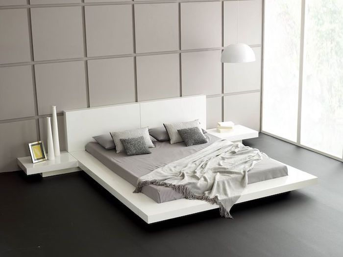 black wooden floor, white bed frame and shelves, grey tiled wall, tall windows, pinterest bedroom