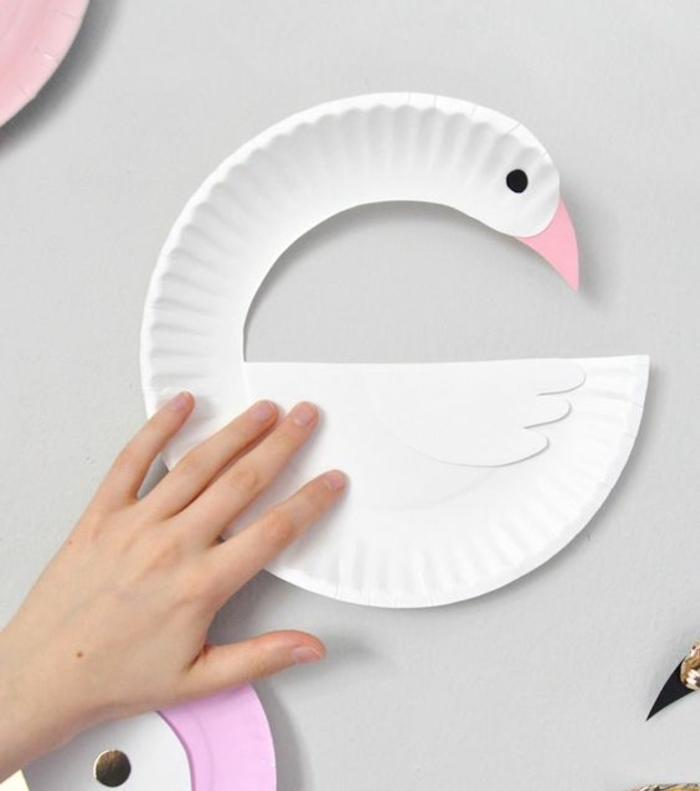 white swan, made of a paper plate, small group activities for preschoolers, white background
