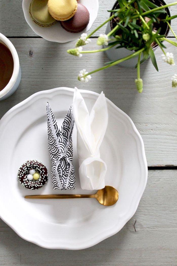 bunny shaped, black and white napkins, chocolate egg nest, brass teaspoon, napkin folding with silverware