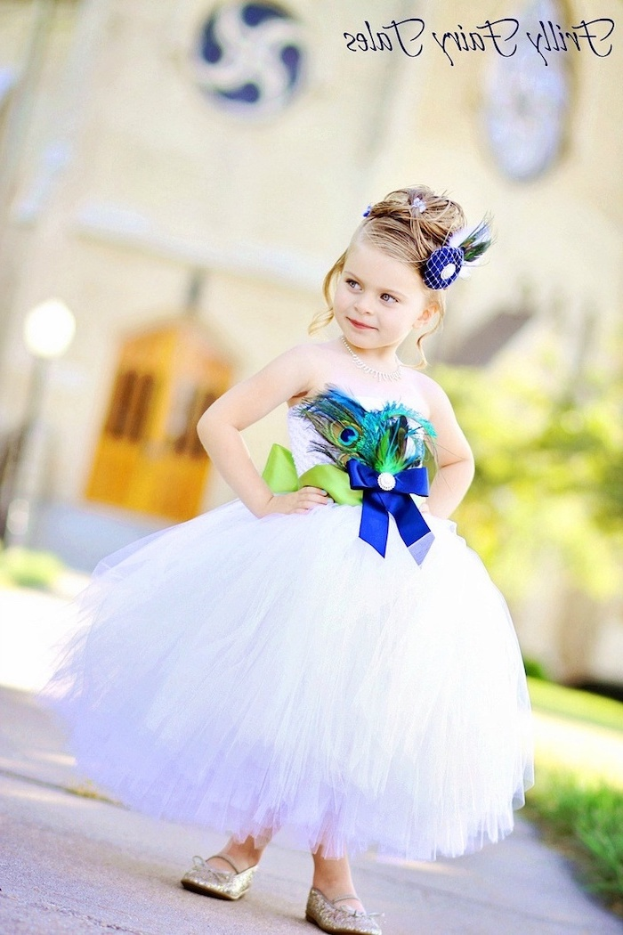 blonde hair, white tulle dress, green and blue bows, peacock feathers, girls dresses for special occasions