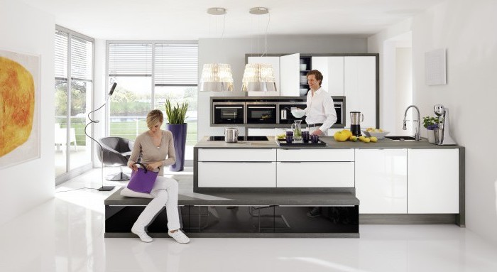 white cabinets, grey countertops, how to make a kitchen island. white floor, tall windows