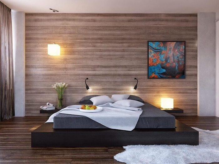 wooden accent wall, black bed frame, how to decorate a bedroom, wooden floor, white rug
