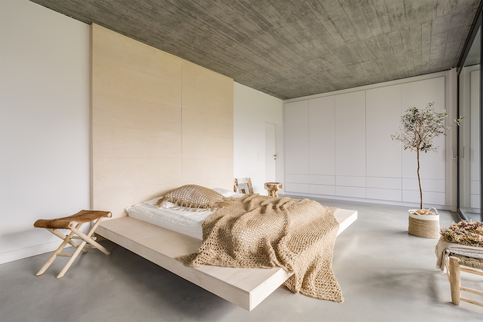 floating wooden bed, white walls, wooden floor, master bedroom ideas, wooden chairs