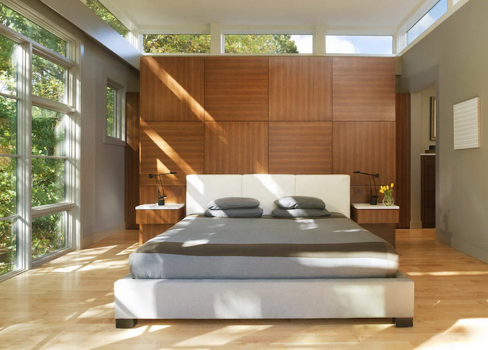 wooden tiled accent wall, grey walls, large windows, wooden floor, white bed frame, bedroom wall ideas