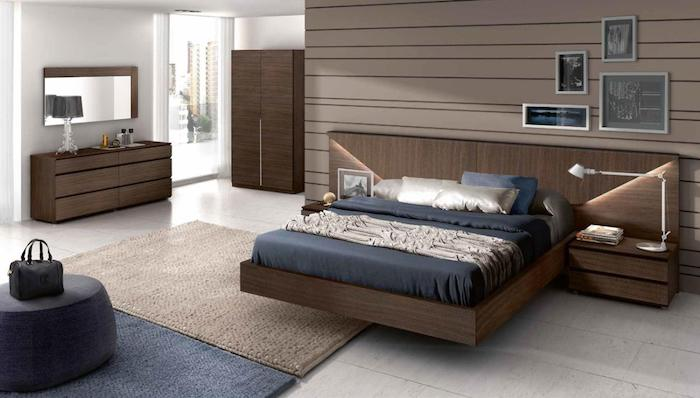 how to decorate room, wooden floating bed, wooden drawers and night stands, blue ottoman