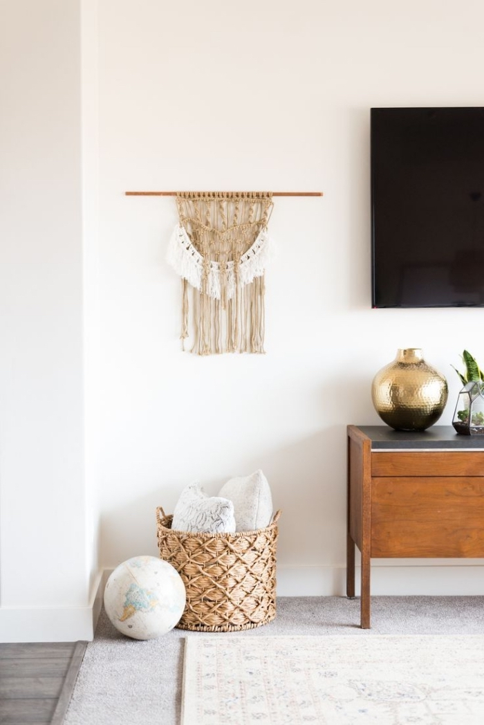 wooden cabinets, wooden basket, woven tapestry wall hanging, wooden floor