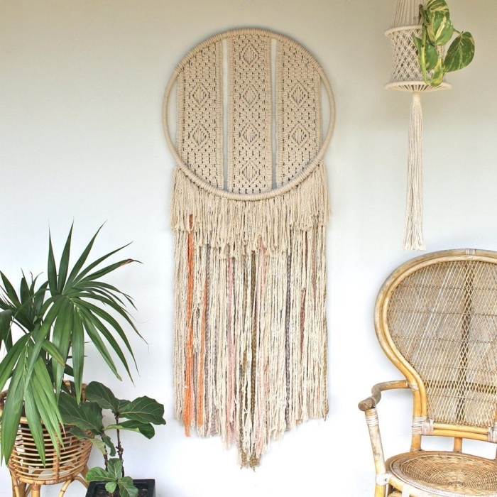 wooden chair, macrame backdrop, potted plants, plant hanger, white wall