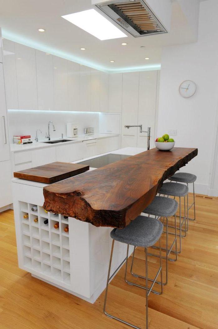 wooden countertop, grey metal bar stools, kitchen island with seating for 4, wooden floor, white cabinets