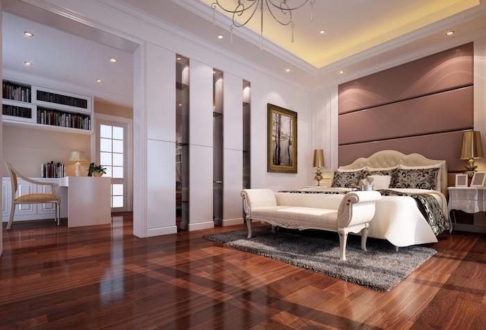dark wooden floor, white walls, white ottoman, leather headboard, master bedroom wall decor, grey carpet