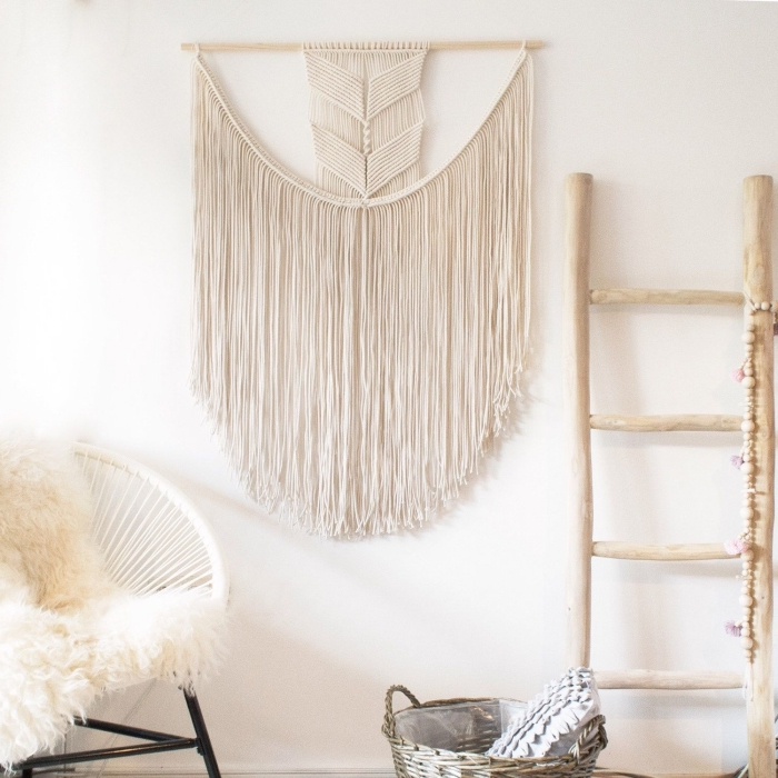 wooden ladder, macrame wall hanging knots, white chair, furry blanket, white wall, wooden basket
