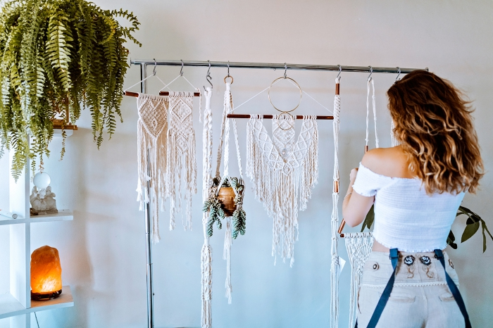 potted plant, wooden shelf, how to macrame, hanging macrame, woman knitting, white wall