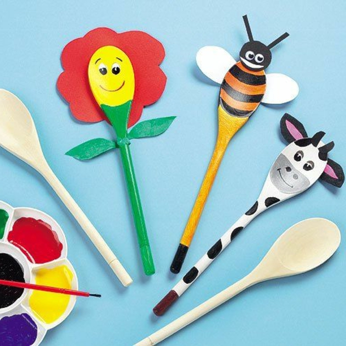 small group activities for preschoolers, wooden spoons, tuned into animals, cow and bee, red flower