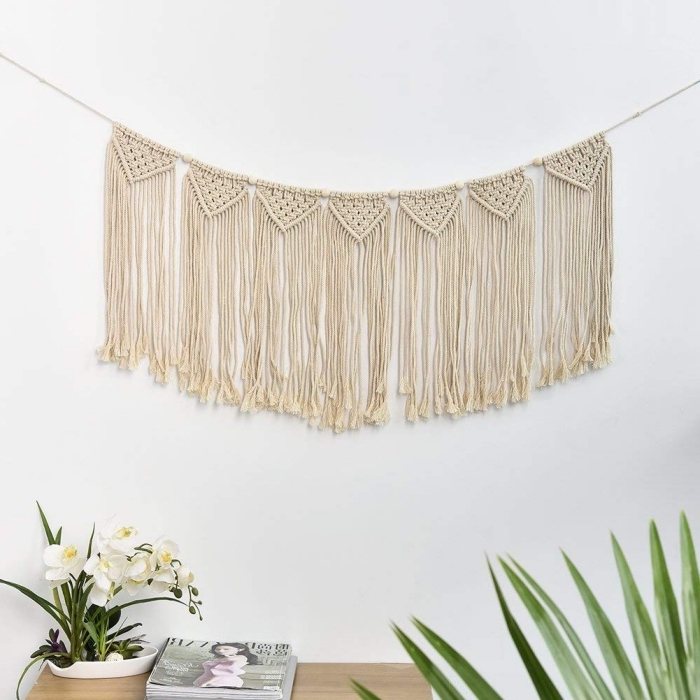 white wall, stack of magazines, learn macrame, white orchids, wooden table