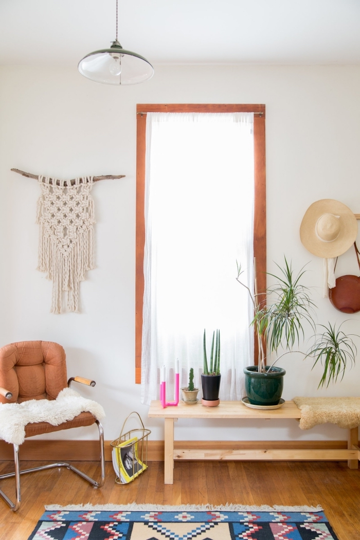 leather armchair, wooden floor, white wall wooden table, potted plants, macrame wall hanging diy